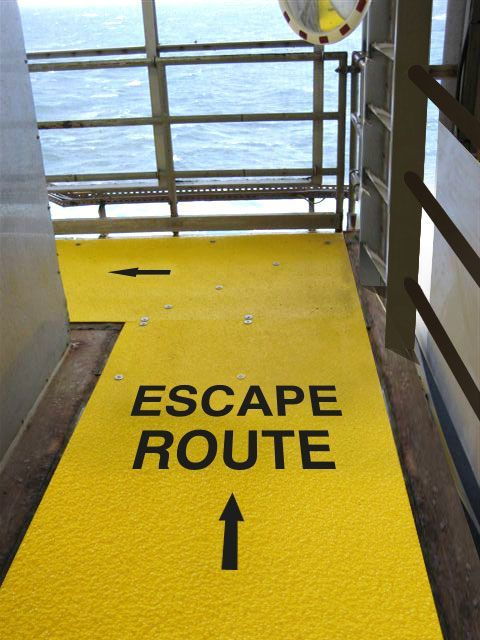 Image of Safeguard anti-slip walkway cover with safety messaging, escape route, embedded on surface.