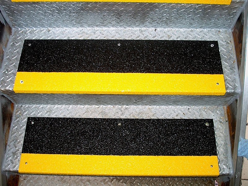 Image of two-tone black and safety yellow Safeguard anti-slip step cover