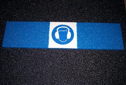 Image of glow-in-the-dark safety symbols on Safeguard anti-slip cover.