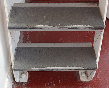 Steps with old anti-slip cover that is worn off