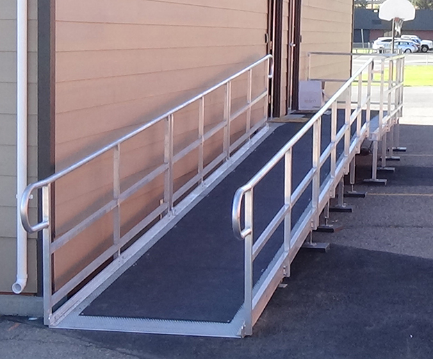 ADA ramp with anti-slip cover